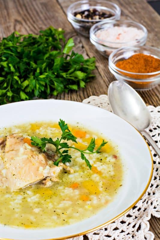 Turkey Soup Recipe shown made in white bowl on wooden table
