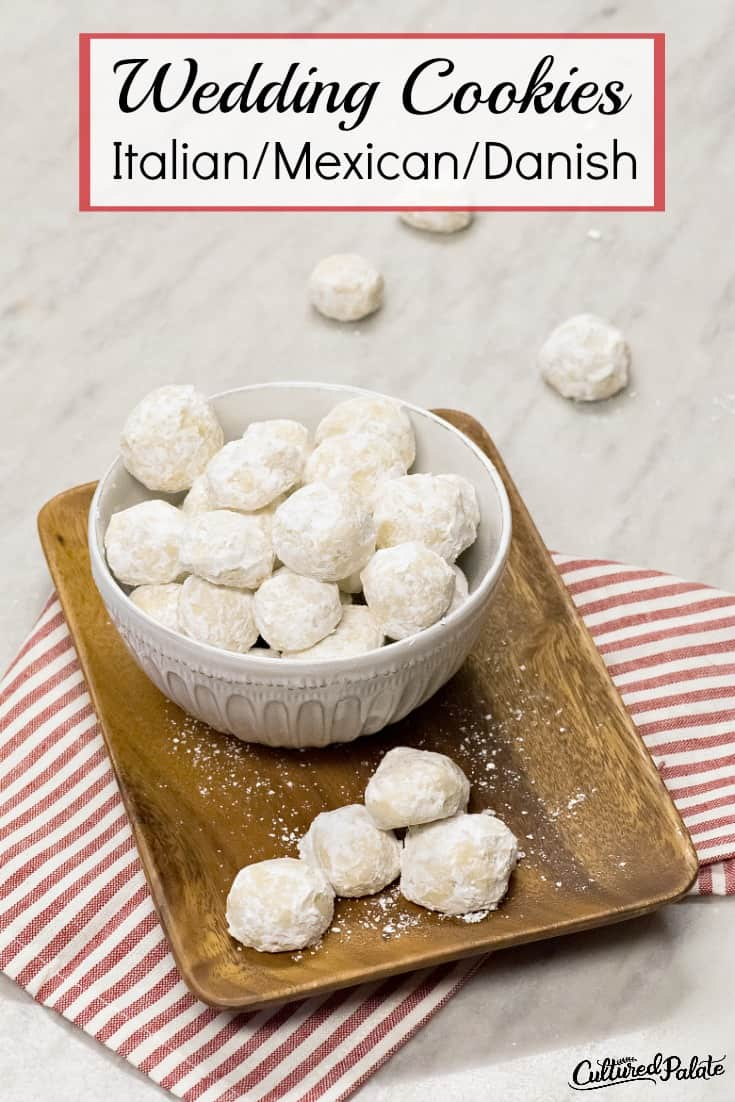 A white bowl of Italian Wedding cookies on a red and white striped napkin with text overall.