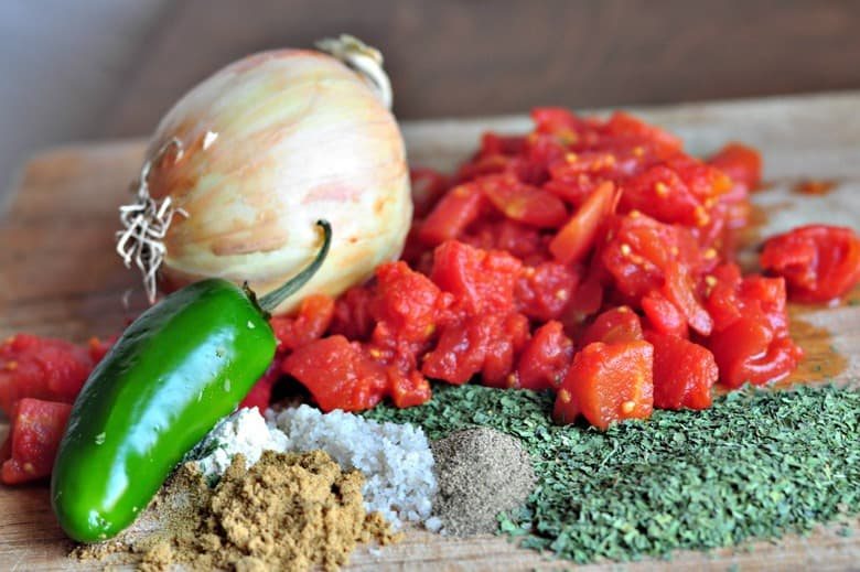ingredients for making an easy homemade salsa recipe on a chopping board