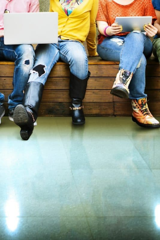 Teen Rebellion illustrated by teens on a bench with various clothes and shoes shown