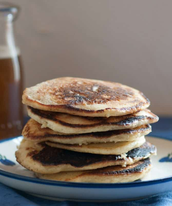 Whole Wheat Pancakes shown stacked on a plate