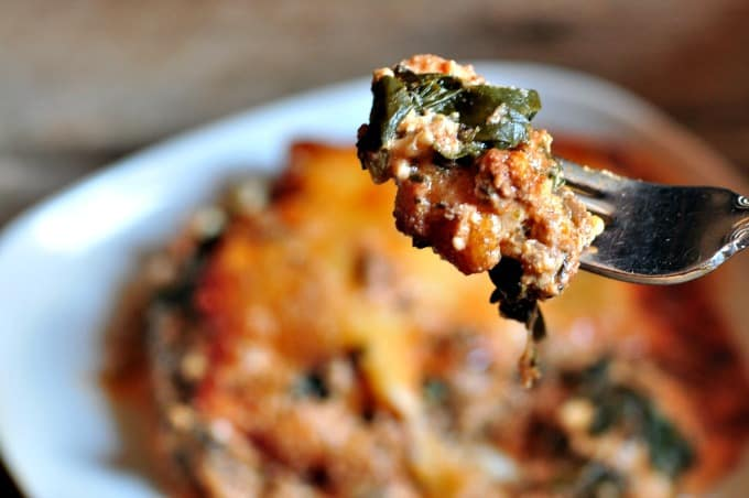 spinach lasagna recipe - A close up of easy spinach lasagna on fork