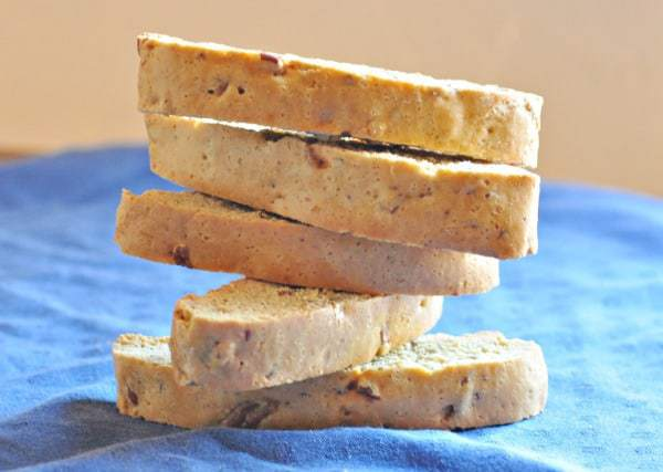 Homemade Pecan Biscotti Recipe shown stacked on blue table