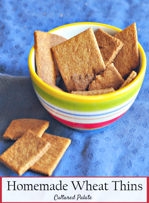 Homemade Wheat Thins Recipe shown in a bowl on blue tablecloth with title of post