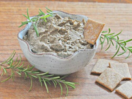 Liver Recipe - Liver Pate shown in bowl with cracker and rosemary sprigs