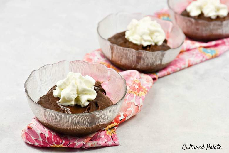 Chocolate Avocado Pudding  - 3 bowls filled with pudding and topped with whipped cream