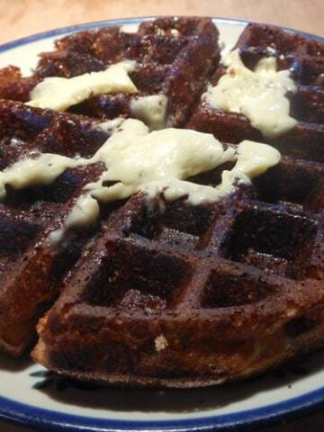 A photo of healthy waffles on a white and blue plate