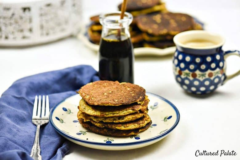 Butternut Squash Pancakes - Paleo Pancakes stacked on top of each other on a blue and white plate