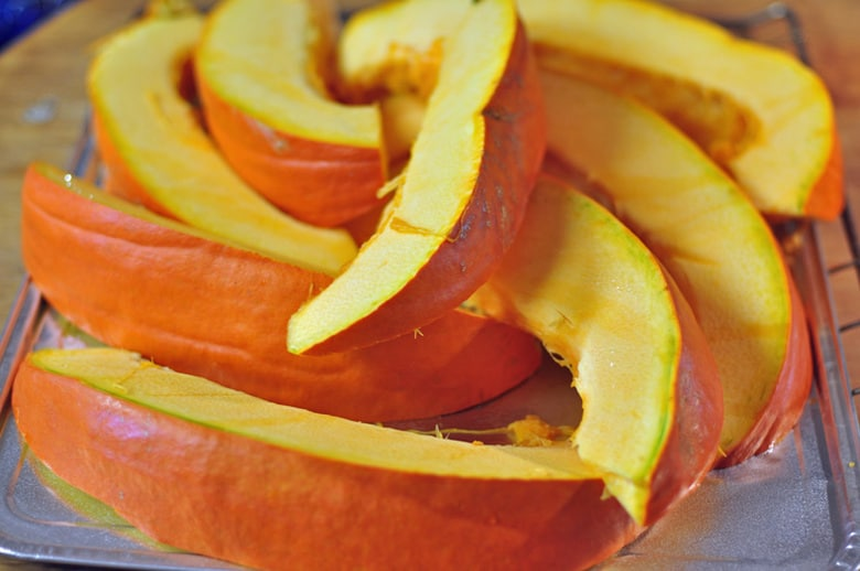 Squash cut into wedges ready to be baked in the oven