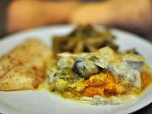 A close up of a Brussels sprouts casserole on a white plate
