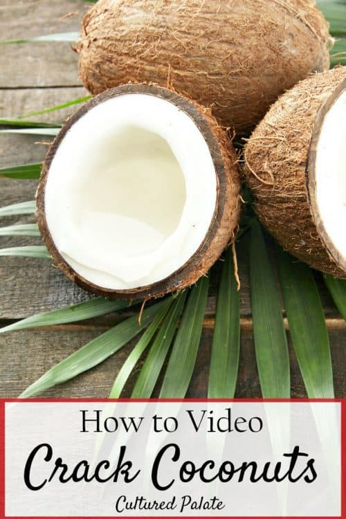 open coconut shown on wood table from How to Crack Coconuts Video Tutorial
