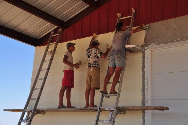 Applying the EIFS using ladder jacks