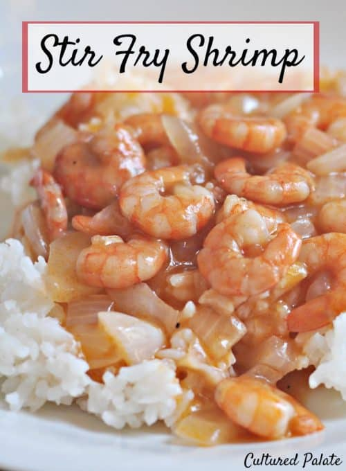 Shrimp with tomato sauce shown on plate with title