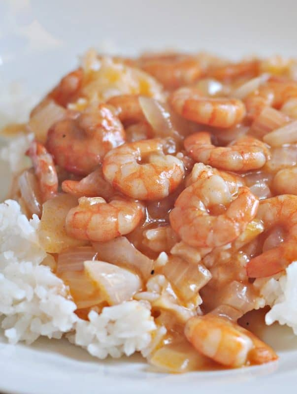 Shrimp with tomato sauce shown on plate