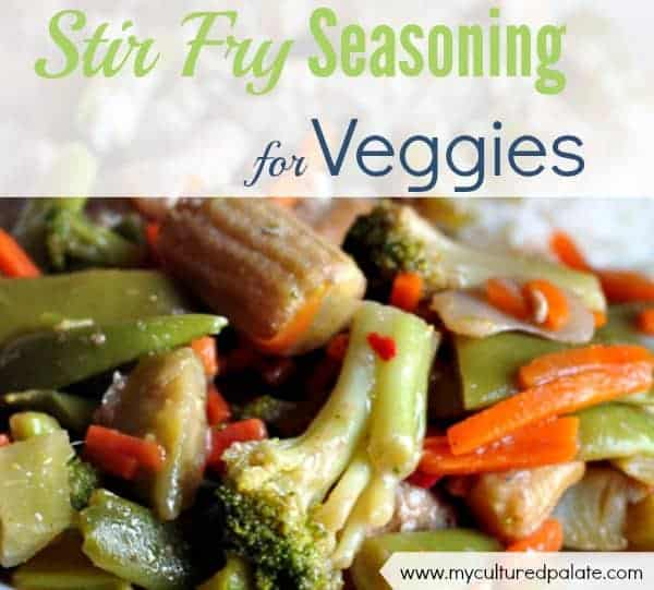 A close up shot of vegetables with stir fry seasoning for vegetables written in text at the top