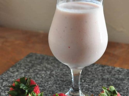 Strawberry kefir smoothie in a tall glass