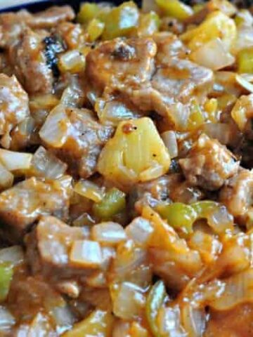A close up of Chinese sweet and sour pork on a plate