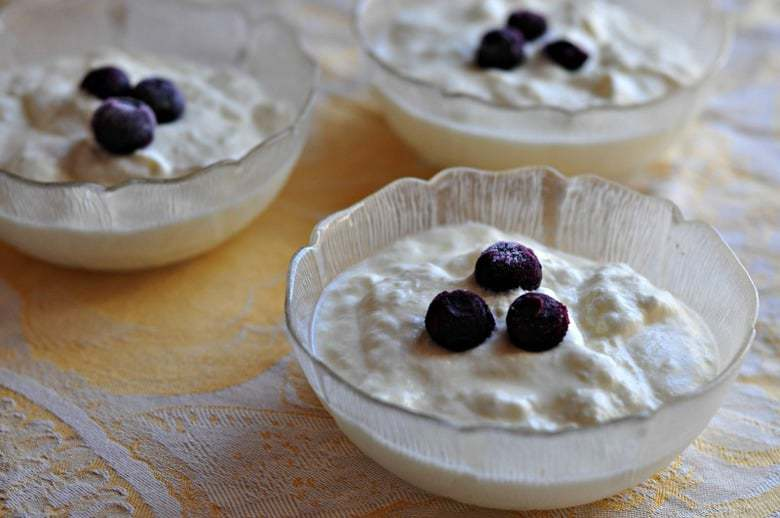 A process shot for how to make Greek yogurt showing the final product in a bowl