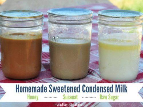 Three jars of homemade sweetened condensed milk on a table