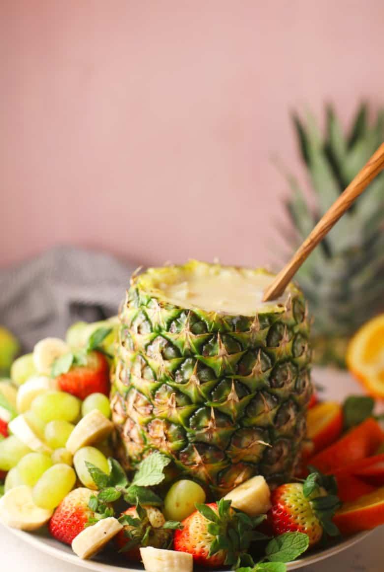 Fruit dip recipe shown in pineapple shell.