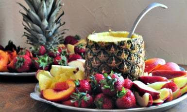 fruit tray with ornage fruit dip