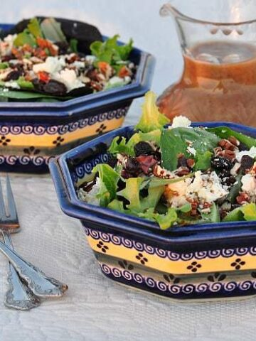 two bowls of feta salad on a table