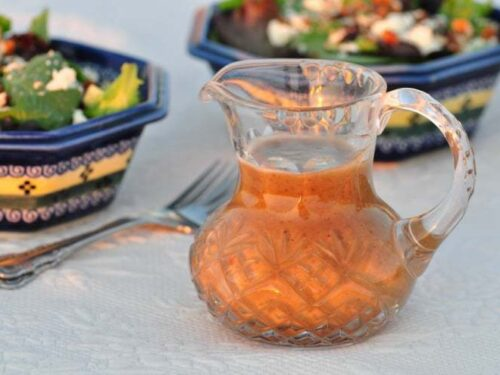 vinaigrette dressing in a jug on a white table