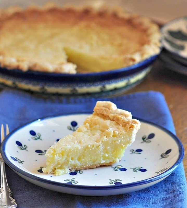 A piece of buttermilk pie on a plate