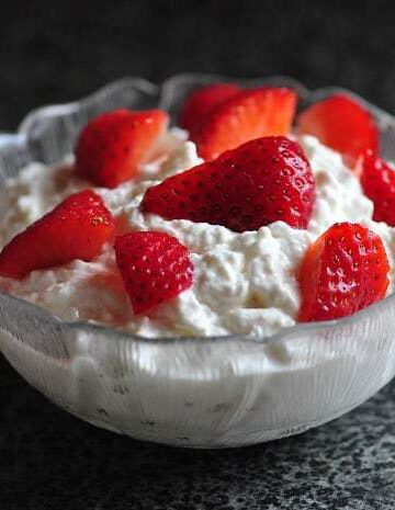 A close up of homemade cottage cheese in a glass bowl