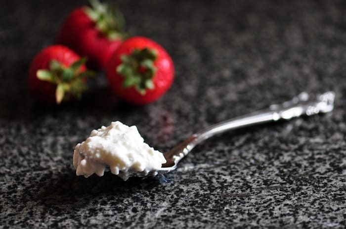 cottage cheese on spoon