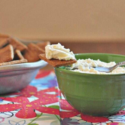 Ricotta cheese recipe shown made in a bowl and on a cracker from the post, how to make ricotta cheese