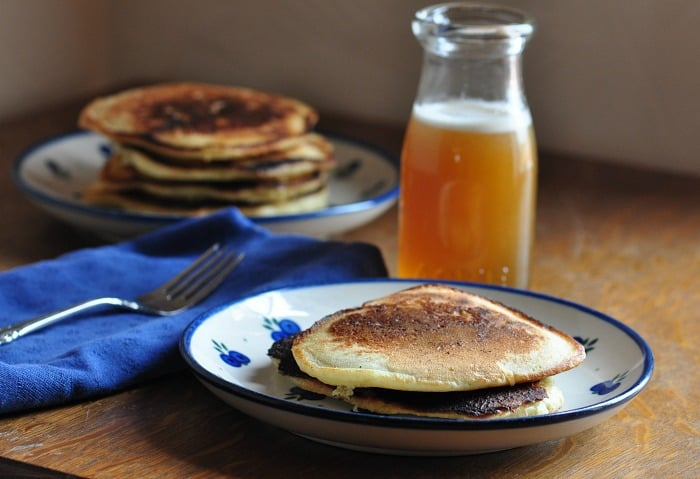 sourdough pancakes on table with honey syrup