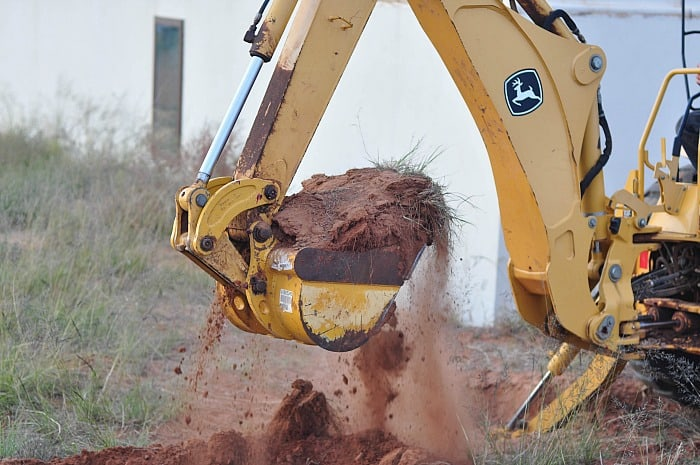 Building with ICF - Phase 2 - scoop of dirt in backhoe bucket