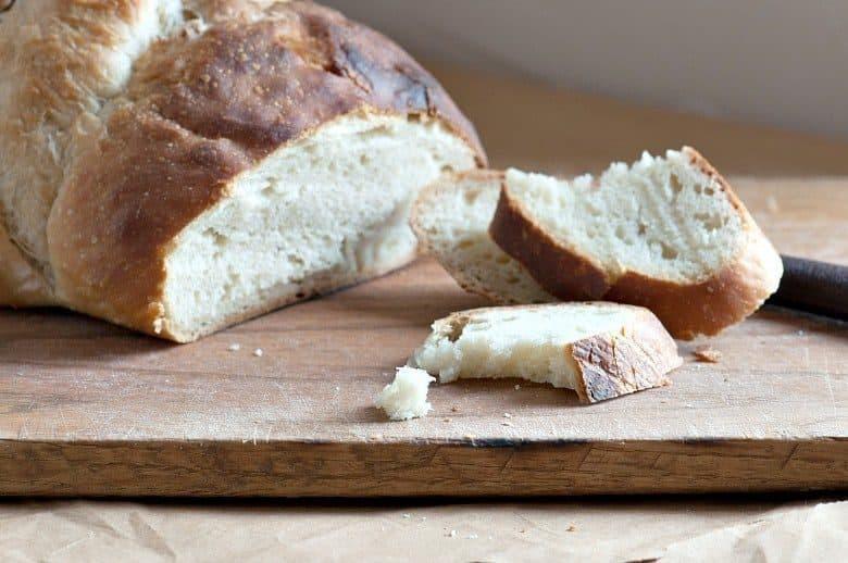 Sourdough Bread Recipe shown on cutting board and cut