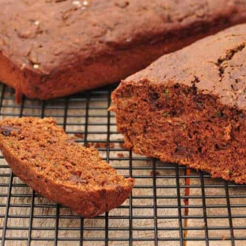 chocolate zucchini bread with a slice cut on a wire rack