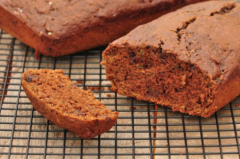 A close up view of chocolate zucchini bread with a slice cut