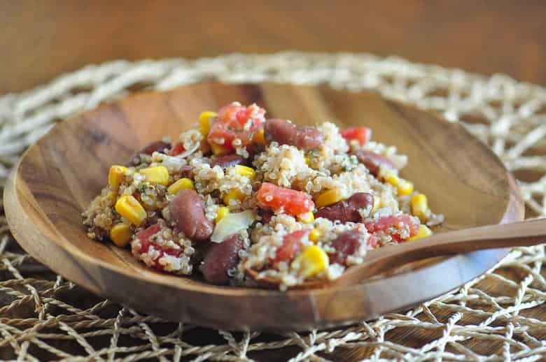 photo of an easy quinoa salad Mediterranean in a wooden bowl