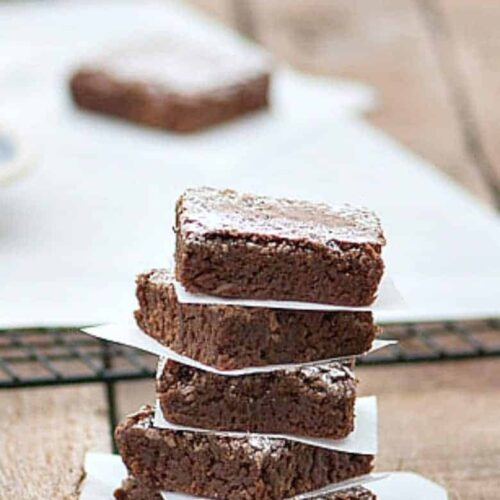 The Best Brownies made from the Easy Brownie Recipe stacked on table