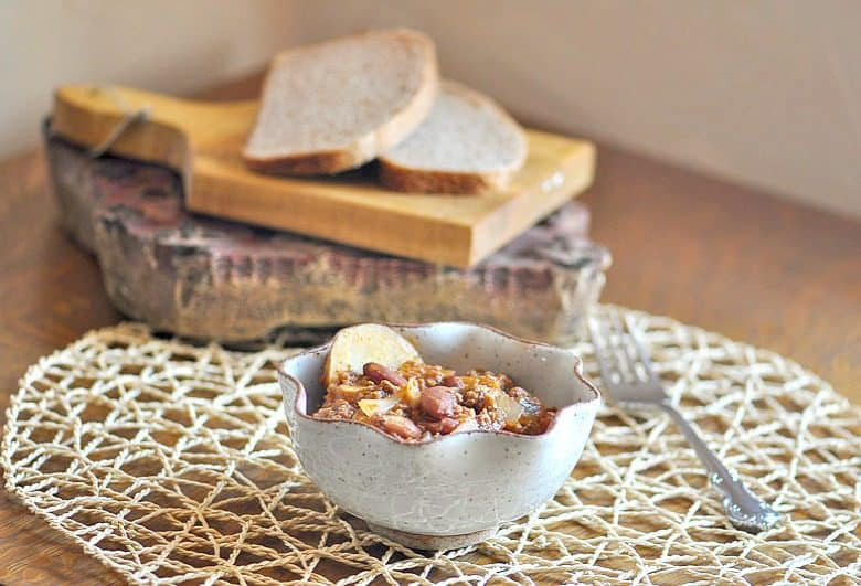 easy chili crockpot recipe in bowl on table with bread