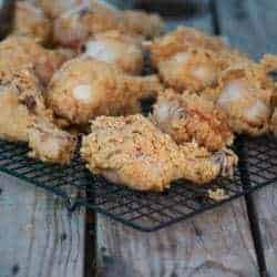 fried kefir battered chicken sitting on a tray