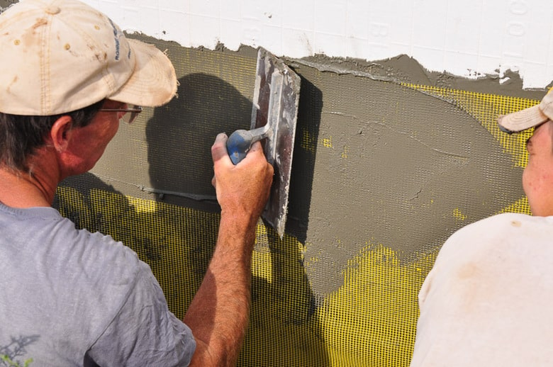 Pressing the cement into the fiberglass mesh of EIFS