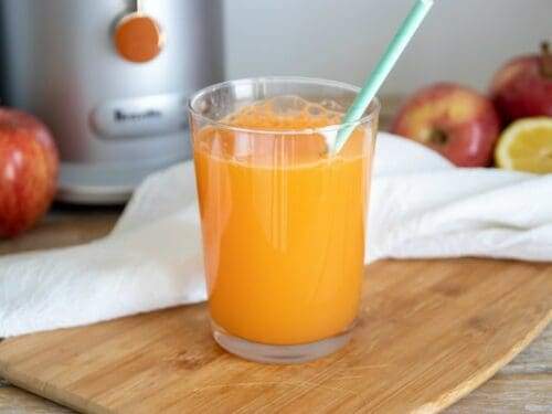 Easiest carrot juice recipe shown ready to drink in glass.