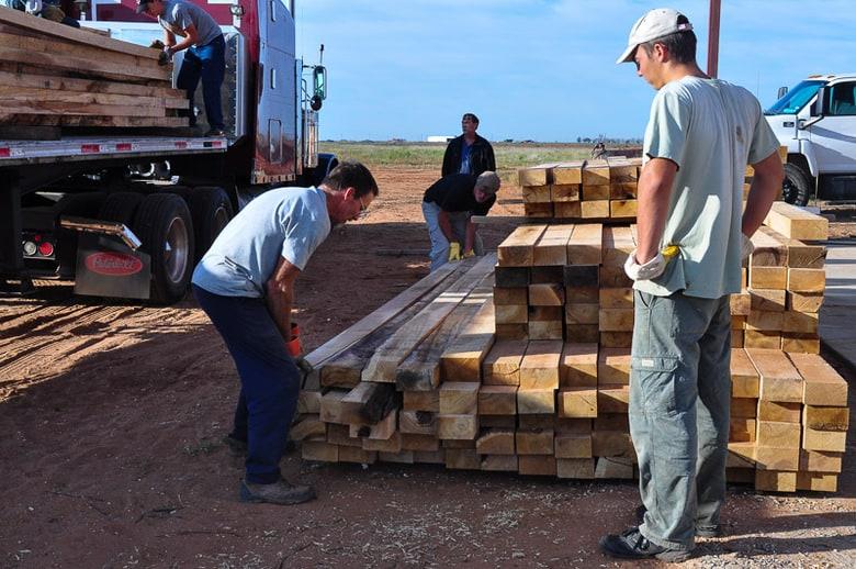 unloading oak hardwood for drying