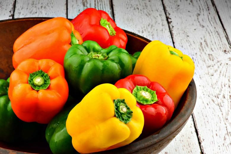 bright colored peppers in a bowl ready to make easy stuffed bell peppers