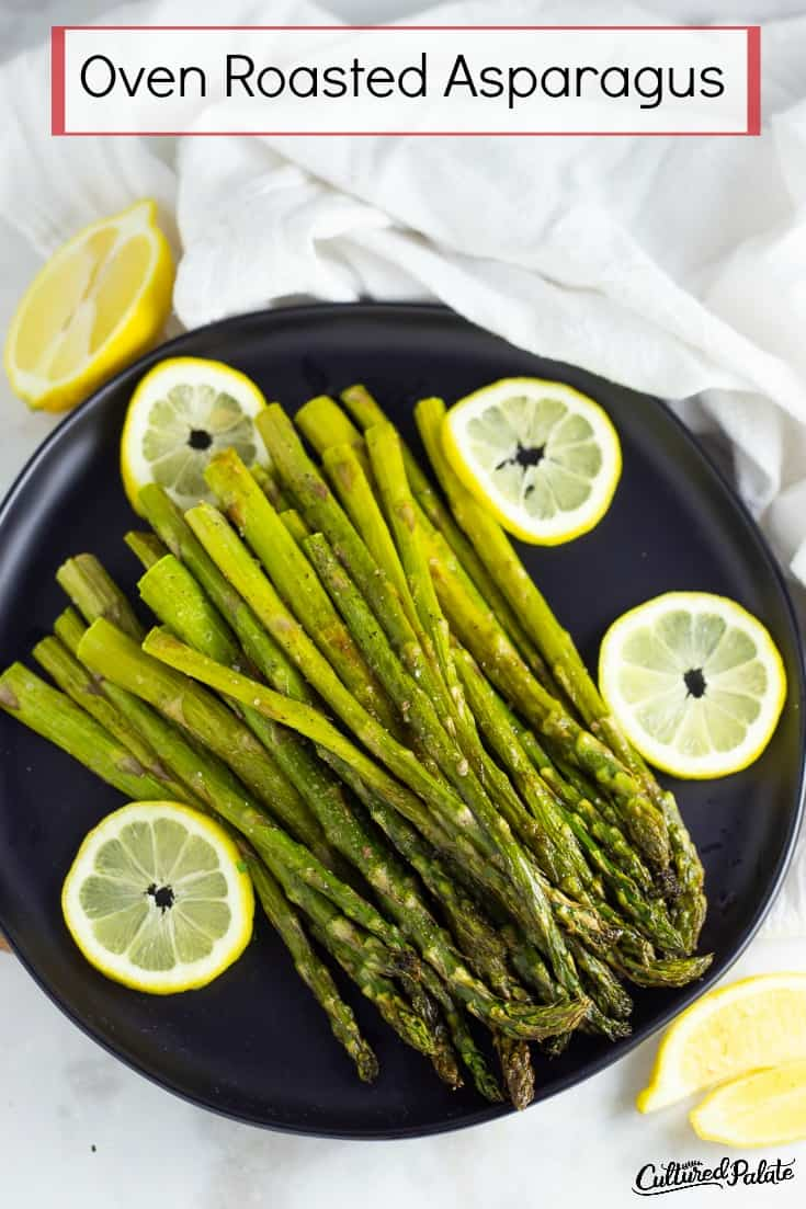 Overhead vertical image of oven roasted asparagus on black plate with text overlay.