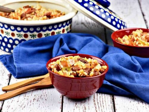 Spicy kidney beans and rice in a small red bowl