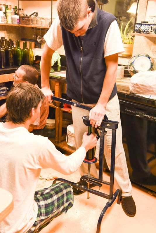 Bottling Montepulciano Wine - Forcing the Cork into the Wine Bottle