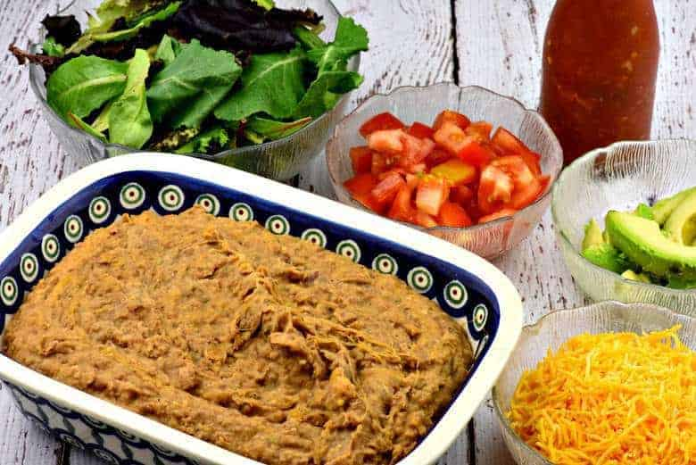 Homemade Refried Beans in a large baking dish on a table