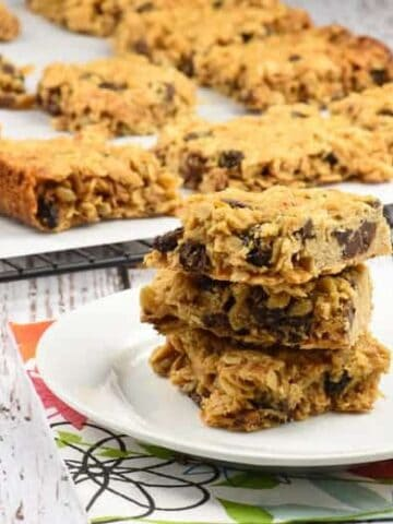 Homemade granola bars stacked on top of each other on a plate