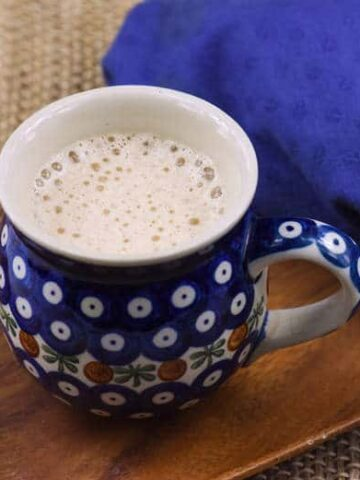 coconut coffee in a large mug on a wooden surface